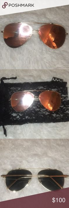 Rose Gold Sunnies Brand new never worn rose gold mirrored sunnies (sunglasses) Comes in a beautiful black laced NYX cosmetics bag In perfect condition Great especially for blocking out the haters (real talk... we all have them) ;) NYX Accessories Sunglasses