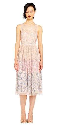 Talk about an instant classic, this midi dress has stunning details in spades. This party dress features an illusion neck and back, a fit and flare silhouette, and elegant floral beaded details throughout. Ombre beading brings a new dimension to this dress. This cocktail dress is complete when paired with a neutral heel.