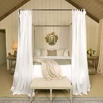 bedrooms - gray vaulted ceiling white wood paneling iron canopy bed white sheers salvaged wood nightstands French bench  Monochromatic bedroom