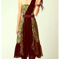 FREE PEOPLE Cross Sash 'Festival dress' Size 0 New with tags. Coachella 'Festival' Free People Exclusive. Size 0. Black sheer over the shoulder sash with tiered mid calf gypsy boho layers in olive, gold, plum and black. Gorgeous. Free People Dresses