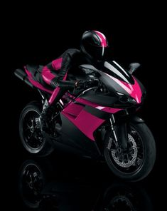 Beautiful Ducati motorcycle in pink and black. I want and need it sooo bad!!! ...and the license to match!! lol