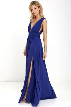 You'll be goddess-like for the entire evening in the Heavenly Hues Royal Blue Maxi Dress! Georgette fabric drapes alongside a V-neck and back, and lays across a banded waist. Full maxi skirt has a sexy side slit. Hidden back zipper with clasp.
