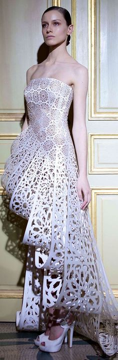 You take a bunch of paper doilies and table runners and voila! ~~ RamiAlAli - Couture S/S 2012 #Lasercut