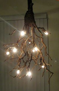 Confessions of Crafty Witches DIY branch chandelier. :) Easy to make from found wooden branches, hemp string to bind them and a string of outdoor globe lights. Perfect for a covered porch or a terrace/patio with an overhead trellis. Branch Chandelier, Rustic Chandelier, Chandelier Lighting, Small Chandeliers, Driftwood Chandelier, Chandelier Crystals, Chandelier Ideas, Outdoor Chandelier, Table Lighting