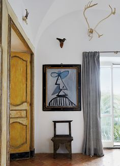 A faux Picasso painted by Cy Twombly hangs in Nicola Del Roscio's dining room in Gaeta, Italy. Photo: Simon Watson.