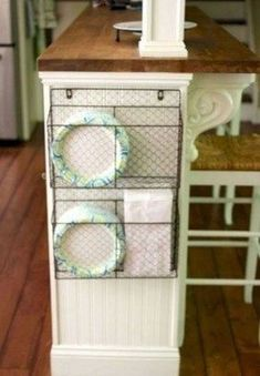Wire basket for storage on side of kitchen island with bead board, part of Ikea . Wire basket for storage on side of kitchen island with bead board, part of Ikea Hack Kitchen Island via www. Diy Kitchen Storage, Kitchen Organization, Organization Hacks, Basket Organization, Travel Trailer Organization, Basket Storage, Organizing Ideas, Plate Storage, Cabinet Storage