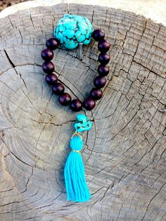 Turquoise bracelet with wooden beads and tassel on Etsy, $10.00