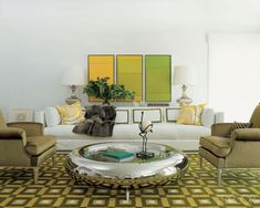 In the Southampton, New York, living room of Reed Krakoff and his decorator wife, Delphine, the sofa is flanked by 1940s armchairs, and the throw pillows are covered in Pucci scarves. The paintings are by Ludwig Sander, the Ring cocktail table is a Garouste and Bonetti design, and the ostrich sculpture is by Diego Giacometti.