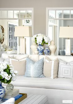 Gorgeous Spring living room decor with blue and white jars faux flowers and gorgeous throw pillows Living Room Pillows, Home Living Room, Living Room Designs, Blue And White Living Room, Classic Living Room, Living Room Decor Blue, White Living Room Furniture, Romantic Living Room, Blue And White Pillows