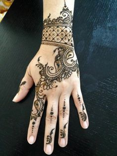 Unique And Beautiful Mehandi Designs @Afshan Sayyed Shahid.   Love the cuff at the wrist  White ink tattoo idea