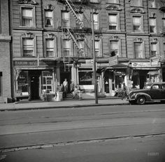 "May 1943. ""New York. A tenement house in Harlem."" Note the sign advising of COVER. Photo by Gordon Parks, Office of War Information.  Shorpy Historic Picture Archive :: Wise Valet: 1943 high-resolution photo"