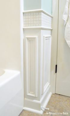 Neat bathroom wainscoting idea from @Tricia @ Simplicity In The South. Add tile above traditional picture frame molding.