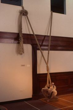 Sinker 19'x3'x2', Clay and rope.[Temporarily installed at Arts Council of Wilson, NC, 2001]