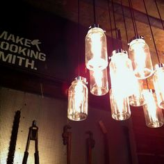 Mason jars hanging from light bulbs industrial interior. Awesome.