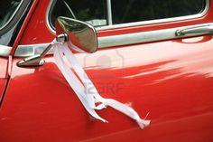 Vintage wedding car in red.
