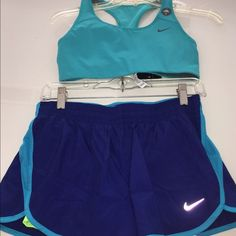 NWT NIKE BRA/SHORT SET SZ SM BRA/S or M SHORTS NWTNIKE BRA/ SHORT SETBRA COMES IN SMALL ONLY BUT YOU HAVE THE OPTION OF  A SMALL OR MED IN THE SHORTS.   The sports bra is Aqua and is Nike's HIGH SUPPORT bra.   The shorts are Nike's  2 2-N-1  SHORTS.  They HAVE TWO SHORTS IN INE PAIR.  The top short is Dark blue trimmed in lighter blue.  The UNDER SHORT IS NEON!!  SEE SECOND P.IC TO SEE 2-N-1  SHORTS.     ‼️‼THESE ITEMS RETAIL FOR $91 PLEASE NO LOWBALL OFFERSTHESE CANNOT BE BUNDLED!!!  LOWEST…