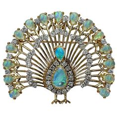 Opal Diamond Gold Peacock Brooch  | From a unique collection of vintage brooches at https://www.1stdibs.com/jewelry/brooches/brooches/