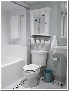 loving the use of IKEA Asker containers above the toilet!!