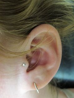star tragus piercing / wish I could man up and get this done already.
