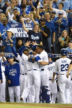 Kansas City Royals Eric Hosmer (left) received a hug from Salvador Perez after hitting a two run home run during the third inning at Sunday's ALDS playoff baseball game on October 5, 2014 at Kauffman Stadium in Kansas City, MO.