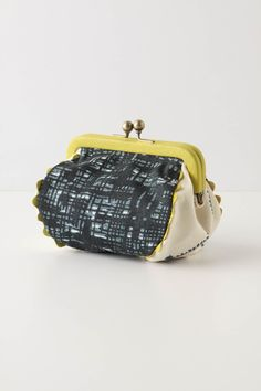 adorable coin purses and clutches at Anthropologie. this one is $28.00
