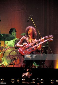 COURT Photo of John BONHAM and Jimmy PAGE and LED ZEPPELIN, L-R: John Bonham (drums), Jimmy Page (playing Gibson EDS-1275 twin-neck/double-neck guitar) performing live onstage