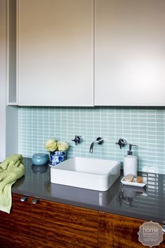 A chic butler-style sink and glass horizontal tiles are a contemporary inclusion in this feminine ensuite. Cosy Bathroom, Bathroom Renos, Laundry In Bathroom, Rustic Style, Modern Rustic, Wooden Vanity, Bathroom Plans, Amazing Bathrooms, Modern Bathrooms