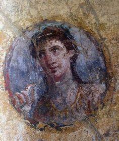 PORTRAIT OF A YOUNG WOMAN / Pompeii, house of the golden putti (Casa degli Amorini dorati, VI, 16,7).– Portrait of a young woman, detail from a wall painting in the cubiculum