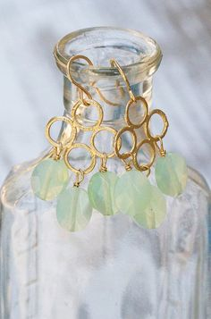 Mint green glass bead earrings on gold 4-circle pendants