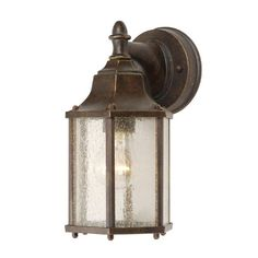 The vintage appeal of this coach lantern with it's clean lines capture an era of simplicity. Finished in Heritage Bronze, the clear glass panels complete the authentic appearance.