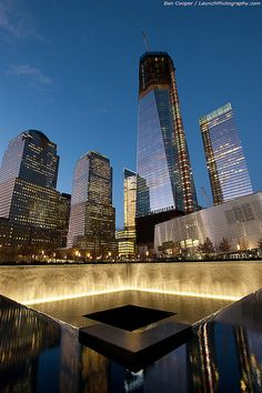 The National September 11 Memorial: The New World Trade Center is coming into shape, towering into the twilight over the spectacular reflecting pools on the 911 memorial site, December 23, 2011.