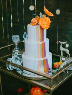 orange + copper cake with poppy cake topper