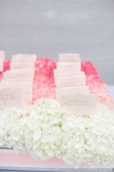 Escort Cards Nestled in Pink Ombre Hydrangeas! http://www.StyleMePretty.com/2013/06/27/old-saybrook-connecticut-wedding-from-true-event-leila-brewster-photography/  -- LeilaBrewsterPhotography.com --  Event Design + Planning: TRUEEvent.com --  Floral Design: Stoneblossoms.com