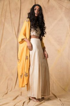 Ivory muga tussar crop top and palazzo pants layered with a mustard muga tussar cape, hand-embroidered with zardozi and thread. Indian Wedding Wear, Indian Wear, Indian Style, Designer Blouse Patterns, Blouse Designs, Palazzo Pants Indian, Asian Fashion, Boho Fashion, Lehenga