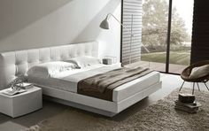 Frida from Misura Emme at Interni: The modern shape of the bed, together with the characteristics of the headboard ...