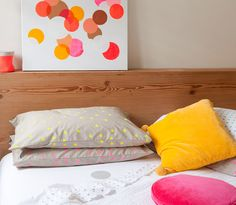 Love these neon dot pillows for the girls' new room.