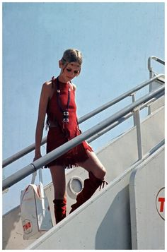 TWA plane at Heathrow Airport, mid 1960s. She is wearing a red tasselled native American style outfit and matching boots. (Photo by Hulton Archive:Getty Images) 1965