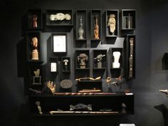 A great booth of smalls displayed in custom shelving. ( in this case a collection of antique folk art, carved hands)