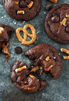 Chocolate Salted Caramel Pretzel Cookies Recipe on twopeasandtheirpod.com Chocolate cookies with a gooey caramel center, pretzel pieces, and a sprinkling of sea salt. These cookies are AMAZING!