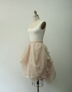 The short version of our Kensington gown!Draped linen skirt in blush  layered with champagne paired with silk jersey ballet tank (sold separately  here). Pair with an easy, casual top or elevate it with an embellished or  textured piece.  Handmade in the heart of NYC's fashion district. Please allow up to 12  weeks for production if not in stock (rush options may be available, so  please contact sales@carol-hannah.com for more information). Return/  exchange within 10 days of receipt, less…