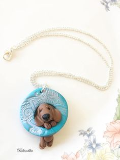 Red dachshund hanging on mandala-necklacepolymer