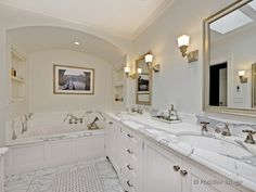 Soaker bathtub with arched ceiling and shelves for towels and toiletries