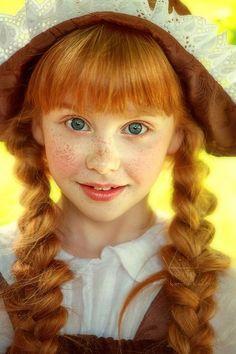 Cute girl - red hair and braids...
