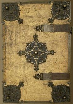 """The front cover of the newly digitised Geese Book (1503-1510).  Pigskin binding with brass.  This book is 25.75"""" x 17.5"""" in size with gilt, stamped edges.  And I used to complain about my text books in school!  Manuscript made available online yesterday by the good people at the Arizona Center for Medieval and Renaissance Studies."""