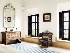 silver-mirror-black-window-frames-blue-white-stripe-rug