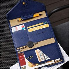 The All-in-One Slim Leather Clutch is a very elegant and well made clutch! The All-in-One Slim Leather Clutch is designed to hold a passport