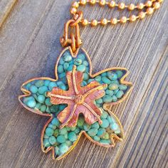 Check out this item in my Etsy shop https://www.etsy.com/listing/556056122/turquoise-blossom-necklace-copper-flower
