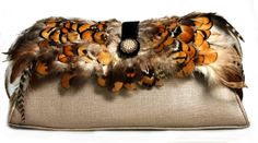 Natural feather detailed with black velvet and white pearls bottomed with tan leather handbag