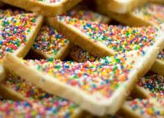 This is fairy bread. I thought it was a universal treat until I moved to London and found out it's really only Aussie kids who grow up on it. Don't be a jerk to yourself. Bread + butter + sprinkles. Make this today.