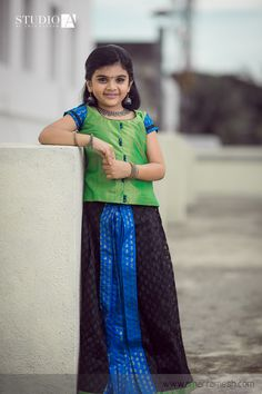 Have you been wondering how to give your daughter a regal look by not comprising on the traditional look?!  Doll her up in this pleated black banaras net skirt added with a touch of pure silk.   Click here to buy it online -  http://www.anyaonline.in/product.aspx?produid=AK0079  Shot by Amar Ramesh Photography